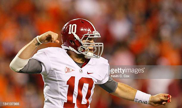 McCarron of the Alabama Crimson Tide reacts after a long offensive play against the Auburn Tigers at JordanHare Stadium on November 26 2011 in Auburn...
