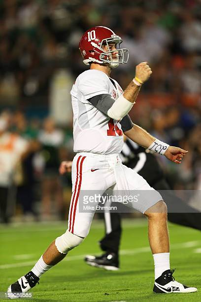 McCarron of the Alabama Crimson Tide reacts after a touchdown run by TJ Yeldon in the second quarter against the Notre Dame Fighting Irish during the...
