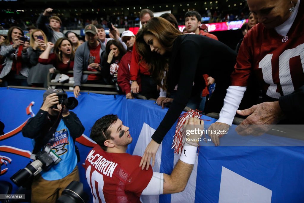 AJ McCarron #10 of the Alabama Crimson Tide talks wtih Katherine Webb after losing to Oklahoma Sooners 45-31 during the Allstate Sugar Bowl at the Mercedes-Benz Superdome on January 2, 2014 in New Orleans, Louisiana.