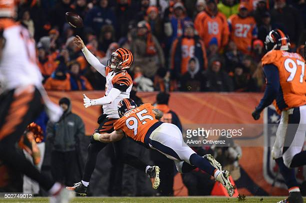 McCarron of the Cincinnati Bengals gets rid of the ball while under pressure from Derek Wolfe of the Denver Broncos in the fourth quarter The Denver...