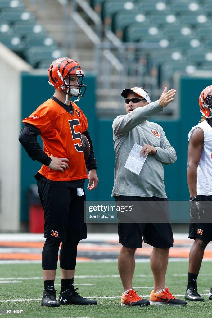 AJ McCarron #5 of the Cincinnati Bengals listens to quarterbacks coach Ken Zampese during an organized team activity (OTA) workout at Paul Brown Stadium on June 3, 2014 in Cincinnati, Ohio.