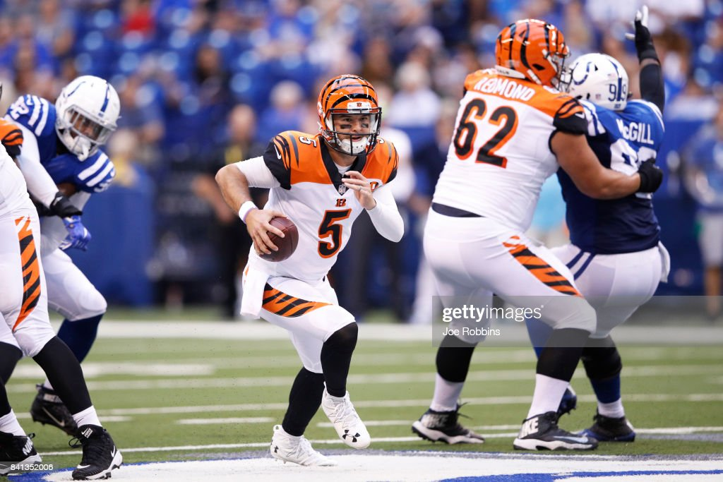 AJ McCarron #5 of the Cincinnati Bengals runs with the ball in the first half of a preseason game against the Indianapolis Colts at Lucas Oil Stadium on August 31, 2017 in Indianapolis, Indiana.
