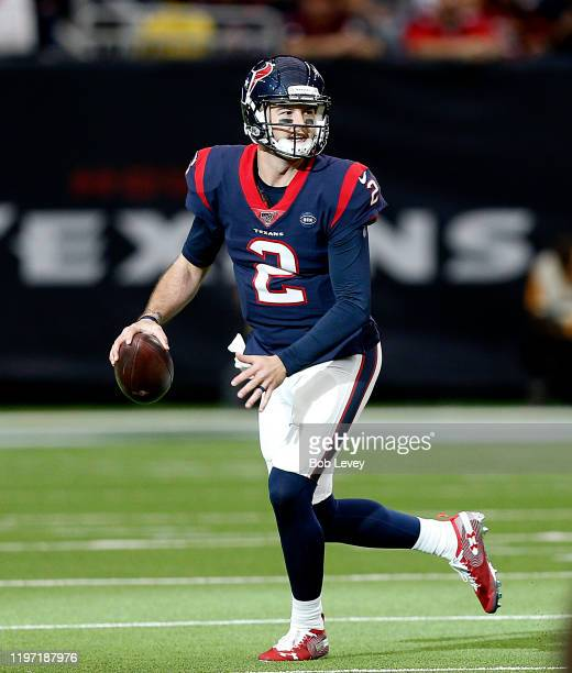 McCarron of the Houston Texans scrambles out of the pocket looking for a receiver during the fourth quarter against the Tennessee Titans at NRG...