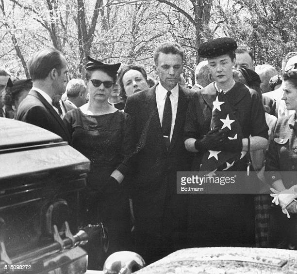 McCarthy Buried. Appleton, Wisconsin: Holding the flag that was draped over her husband's casket, Mrs. Joseph R. McCarthy watches as the casket is...