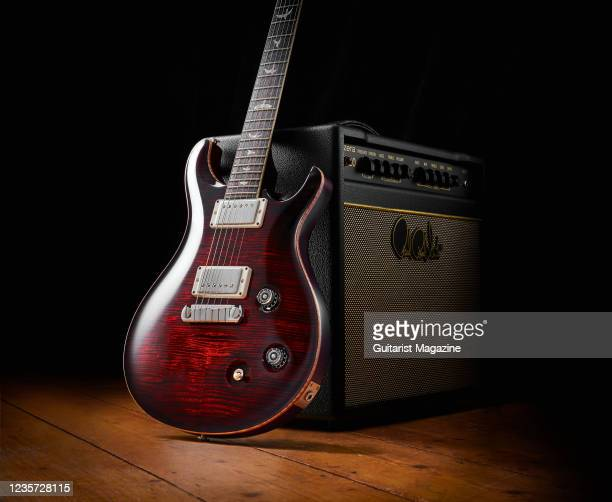 McCarty electric guitar with a Fire Red Burst finish and PRS Sonzera 20 combo amplifier, taken on April 1, 2020.
