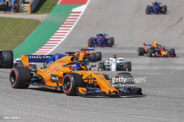 McClaren driver Fernando Alonso of Spain makes his way around the track during the warmup lap before the F1 United States Grand Prix on October 21 at...