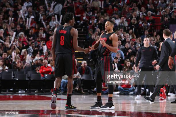 McCollum and AlFarouq Aminu of the Portland Trail Blazers shake hands during the game against the Chicago Bulls on January 31 2018 at the Moda Center...