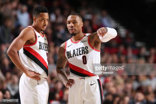 McCollum and Damian Lillard of the Portland Trail Blazers look on against the Memphis Grizzlies on December 19 2018 at the Moda Center Arena in...