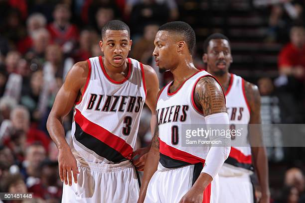 J McCollum and Damian Lillard of the Portland Trail Blazers talk during the game against the New Orleans Pelicans on December 14 2015 at the Moda...