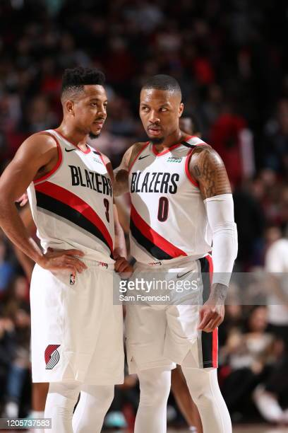 McCollum, and Damian Lillard of the Portland Trail Blazers talk to each other during the game against the Sacramento Kings on March 7, 2020 at the...