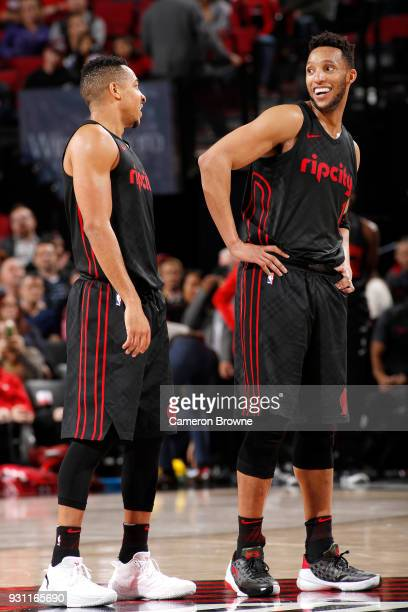 McCollum and Evan Turner of the Portland Trail Blazers talk during the game against the Miami Heat on March 12 2018 at the Moda Center in Portland...