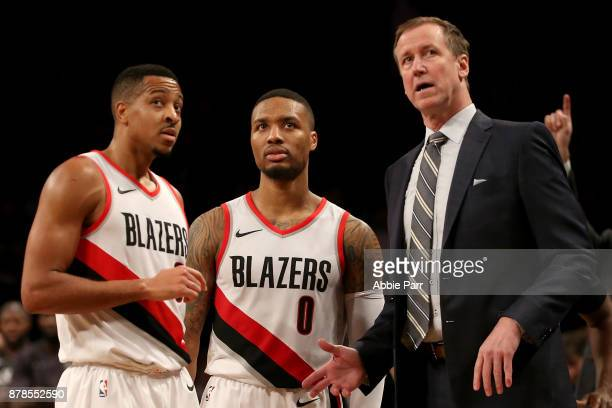 McCollum Damian Lillard and Terry Stotts of the Portland Trail Blazers talk late in the fourth quarter against the Brooklyn Nets at Barclays Center...