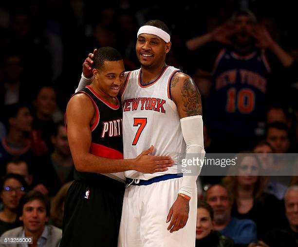 J McCollum of the Portland Trail Blazers and Carmelo Anthony of the New York Knicks embrace after the two collided in the second half at Madison...