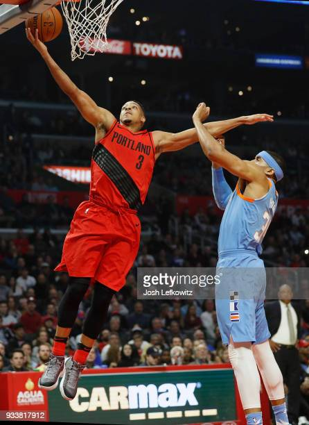 McCollum of the Portland Trail Blazers attempts a layup on Tobias Harris of the LA Clippers during the first half of the game at the Staples Center...