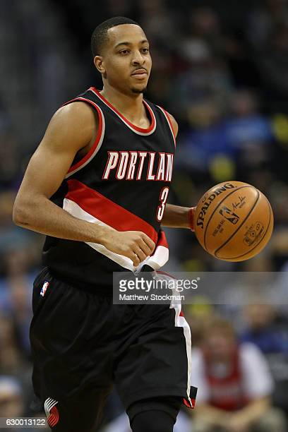 McCollum of the Portland Trail Blazers brings the ball down court against the Denver Nuggets at the Pepsi Center on December 15 2016 in Denver...