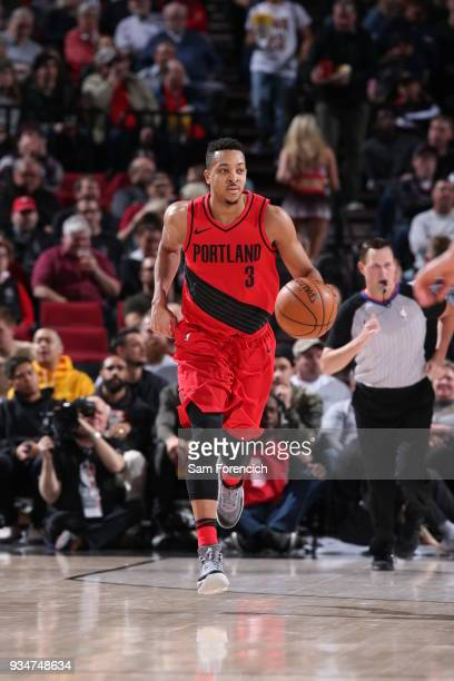 McCollum of the Portland Trail Blazers brings the ball up court against the Cleveland Cavaliers on March 15 2018 at the Moda Center Arena in Portland...