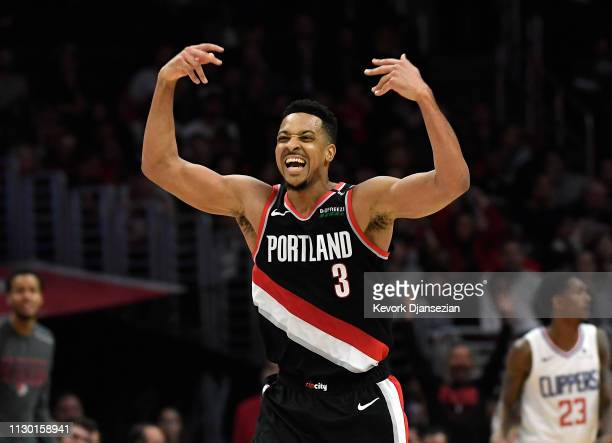 McCollum of the Portland Trail Blazers celebrate after scoring a three point basket against Los Angeles Clippers during the second half at Staples...