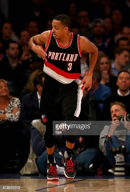 J McCollum of the Portland Trail Blazers celebrates his three point shot in the second half against the New York Knicks at Madison Square Garden on...