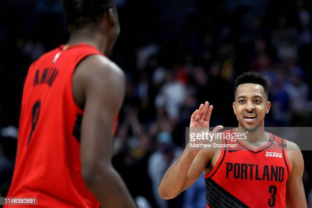 McCollum of the Portland Trail Blazers celebrates with AlFarouq Aminu their win against the Denver Nuggets during Game Two of the Western Conference...