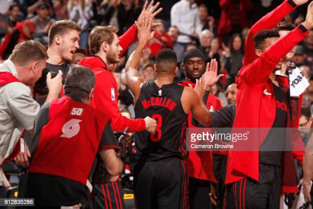 McCollum of the Portland Trail Blazers celebrates with the bench during the game against the Chicago Bulls on January 31 2018 at the Moda Center in...