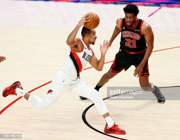 McCollum of the Portland Trail Blazers dribbles against Thaddeus Young of the Chicago Bulls in the second quarter at Moda Center on January 05, 2021...