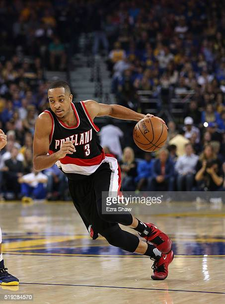J McCollum of the Portland Trail Blazers dribbles the ball against the Golden State Warriors at ORACLE Arena on April 3 2016 in Oakland California...
