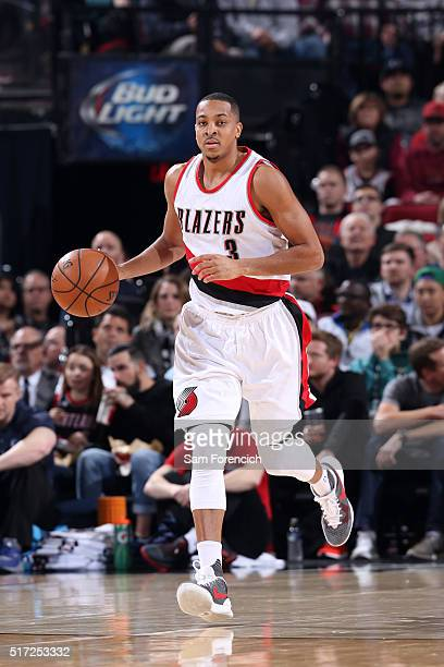 J McCollum of the Portland Trail Blazers dribbles the ball up court against the Dallas Mavericks on March 23 2016 at the Moda Center Arena in...