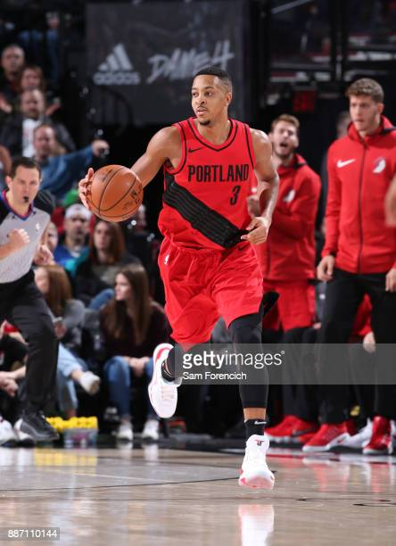 McCollum of the Portland Trail Blazers dribbles the ball up the court against the Washington Wizards on December 5 2017 at the Moda Center Arena in...