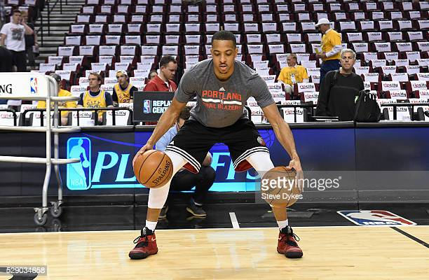 J McCollum of the Portland Trail Blazers dribbles two basketballs as he warms up before Game Three of the Western Conference Semifinals against the...