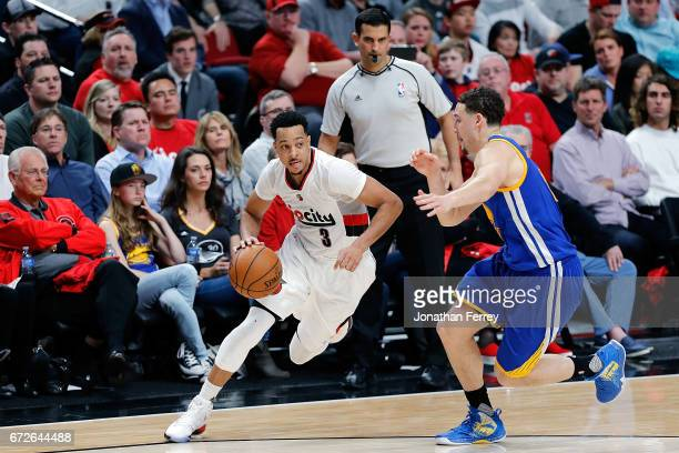 McCollum of the Portland Trail Blazers drives the ball against the Golden State Warriors during Game Three of the Western Conference Quarterfinals of...