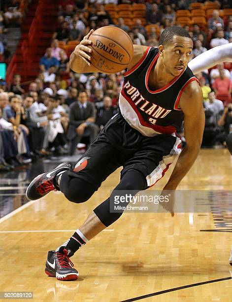 J McCollum of the Portland Trail Blazers drives to the basket during a game against the Miami Heat at American Airlines Arena on December 20 2015 in...
