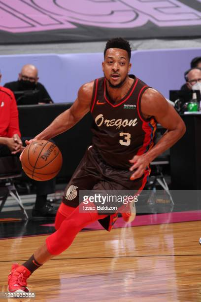 McCollum of the Portland Trail Blazers drives to the basket during the game against the Miami Heat on March 25, 2021 at American Airlines Arena in...