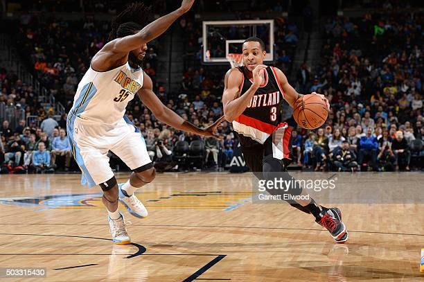 J McCollum of the Portland Trail Blazers drives to the basket during the game against the Denver Nuggets on January 3 2016 at the Pepsi Center in...