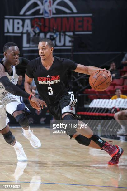 McCollum of the Portland Trail Blazers drives under pressure during the NBA Summer League game between the Atlanta Hawks and the Portland Trail...