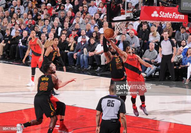 McCollum of the Portland Trail Blazers dunks against LeBron James of the Cleveland Cavaliers on March 15 2018 at the Moda Center Arena in Portland...