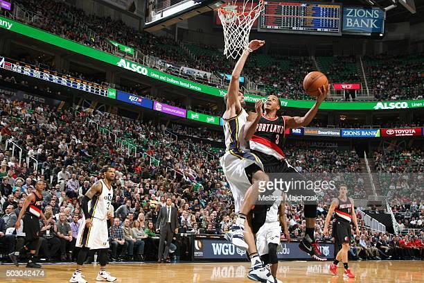 J McCollum of the Portland Trail Blazers goes to the basket against the Utah Jazz on December 31 2015 at vivintSmartHome Arena in Salt Lake City Utah...