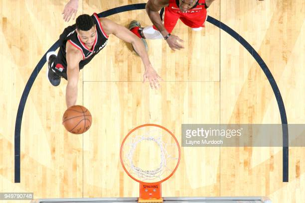 McCollum of the Portland Trail Blazers goes to the basket against the New Orleans Pelicans in Game Four of Round One of the 2018 NBA Playoffs on...