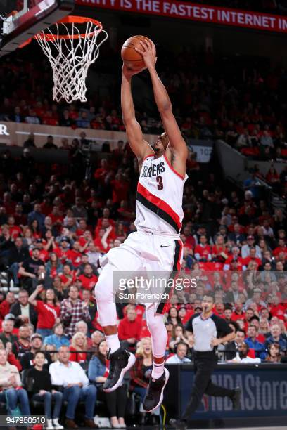 McCollum of the Portland Trail Blazers goes up for a dunk against the New Orleans Pelicans in Game Two of Round One of the 2018 NBA Playoffs on April...