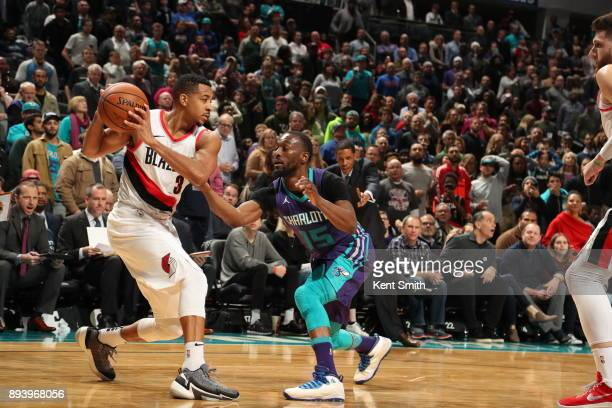 McCollum of the Portland Trail Blazers handles the ball against Kemba Walker of the Charlotte Hornets on December 16 2017 at Spectrum Center in...