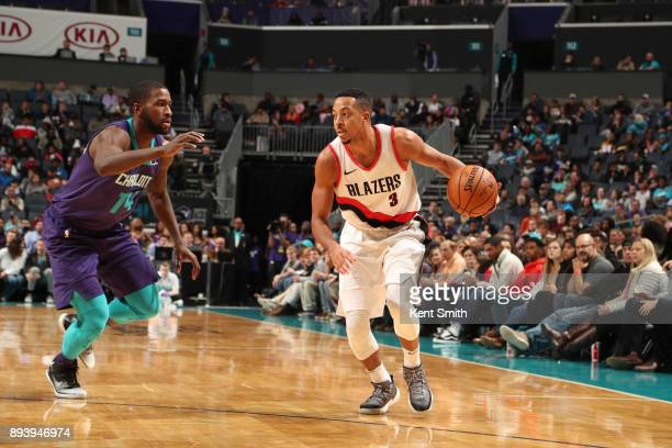 McCollum of the Portland Trail Blazers handles the ball against Michael KiddGilchrist of the Charlotte Hornets on December 16 2017 at Spectrum Center...