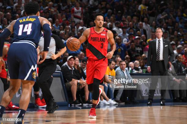 McCollum of the Portland Trail Blazers handles the ball against the Denver Nuggets during Game Seven of the Western Conference SemiFinals of the 2019...