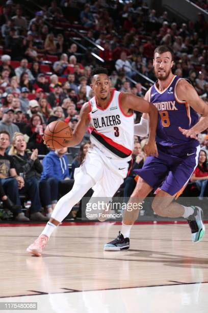 McCollum of the Portland Trail Blazers handles the ball against the Phoenix Suns during a pre-season game on October 12, 2019 at the Moda Center in...