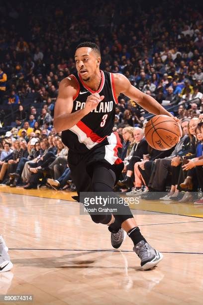 McCollum of the Portland Trail Blazers handles the ball against the Golden State Warriors on December 11 2017 at ORACLE Arena in Oakland California...