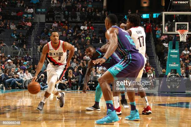 McCollum of the Portland Trail Blazers handles the ball against the Charlotte Hornets on December 16 2017 at Spectrum Center in Charlotte North...