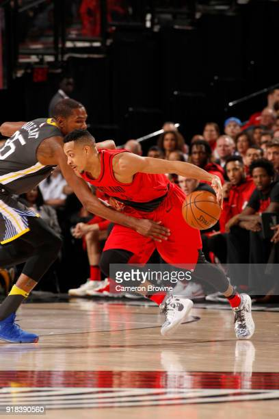 McCollum of the Portland Trail Blazers handles the ball against the Golden State Warriors on February 14 2018 at the Moda Center in Portland Oregon...