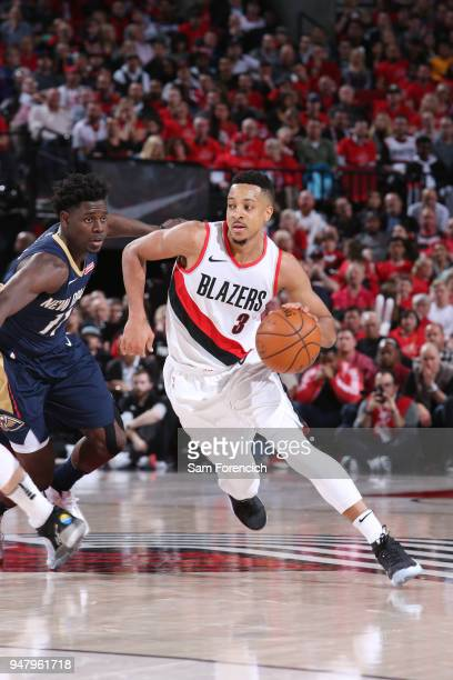 McCollum of the Portland Trail Blazers handles the ball against the New Orleans Pelicans in Game Two of Round One of the 2018 NBA Playoffs on April...