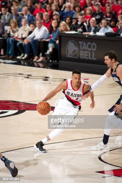 McCollum of the Portland Trail Blazers handles the ball against the New Orleans Pelicans in Game Two of the Western Conference Quarterfinals during...