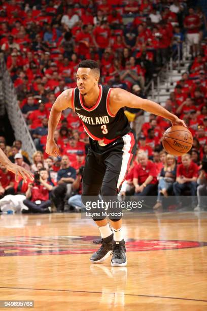 McCollum of the Portland Trail Blazers handles the ball against the New Orleans Pelicans in Game Four of Round One of the 2018 NBA Playoffs on April...