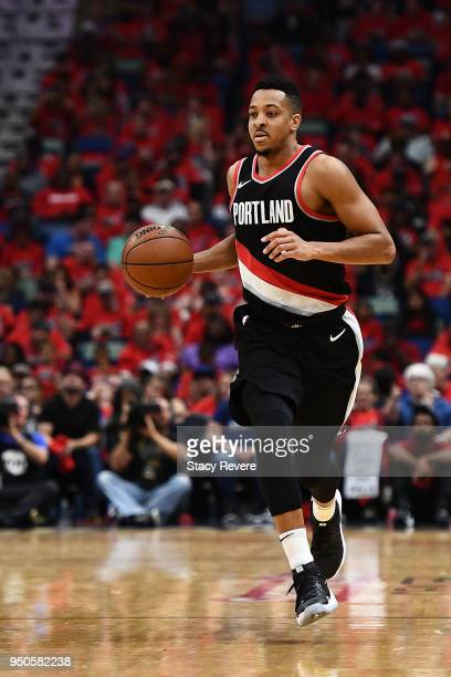 McCollum of the Portland Trail Blazers handles the ball against the New Orleans Pelicans during Game Four of the first round of the Western...
