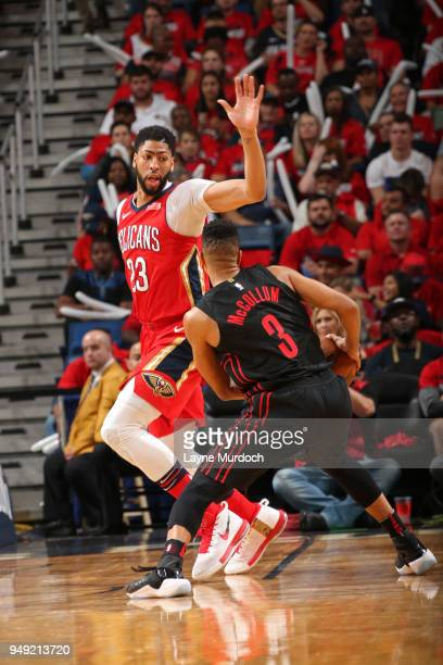 McCollum of the Portland Trail Blazers handles the ball around Anthony Davis of the New Orleans Pelicans in Game Three of Round One of the 2018 NBA...